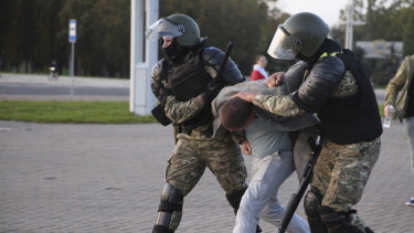 Riot police detain a protester during an opposition rally following the presidential inauguration in Minsk, Belarus.