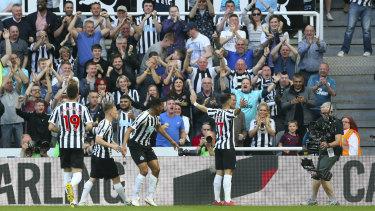 Ayoze Perez, right, celebrates Newcastle's first goal.