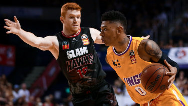 Didi Louzada of the Kings drives to the basket against Illawarra Hawks at WIN Entertainment Centre.
