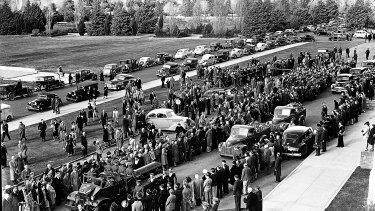 A day of solemn ceremony... Memorial service in Canberra for Prime Minister John Curtin on July 6, 1945.