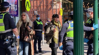 Police at Queen Victoria Market on Sunday morning.