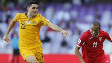 Unlucky break: Tom Rogic played most of the match against Jordan with a fractured hand.