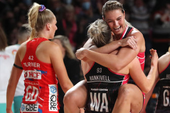 Lenize Potgieter jumps on Maisie Nankivell after victory against the Swifts.