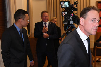 Hijacked: Health Minister Greg Hunt walks away from Chinese consul-general Zhou Long and Andrew Forrest after Wednesday's press conference.