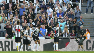 Ayoze Perez, right, celebrates Newcastle's first goal.