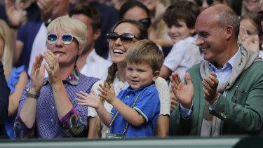 Jelena Djokovic, wife of Novak Djokovic of Serbia and their son applaud after the match.