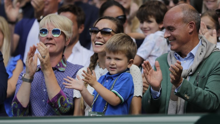 Jelena Djokovic, wife of Novak Djokovic of Serbia and their son applaud after the match.