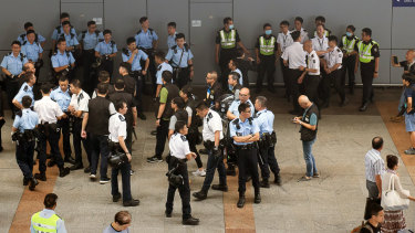 Police and members of airport security stand at the Hong Kong International Airport in Hong Kong, China.