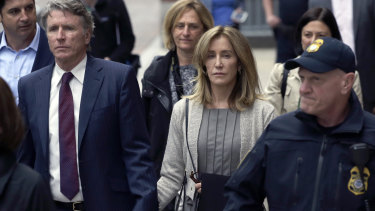 Guilty of college admissions bribery: Felicity Huffman, centre, in federal court.