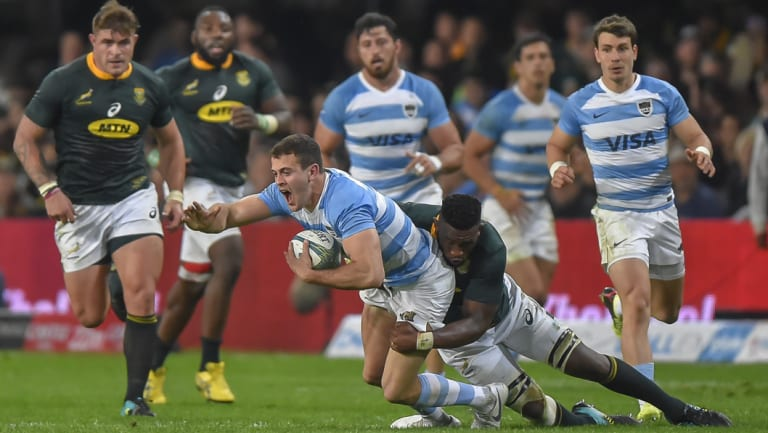 Tough test: Argentina full-back Emiliano Boffelli is tackled during their Rugby Championship loss to South Africa in Durban