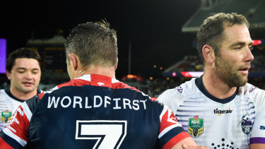 Brush off: Cooper Cronk and Cameron Smith after the Storm's win over the Roosters at Adelaide Oval last year.