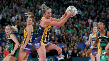 Laura Scherian of the Lightning   gets possession during the Super Netball Grand Final.