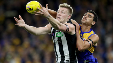 Jordan De Goey battles Thomas Cole for the ball.
