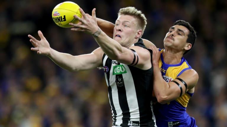 Jordan De Goey battles Thomas Cole for the ball.