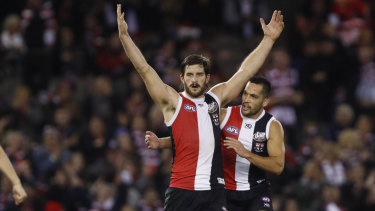 Josh Bruce of the Saints (centre) celebrates a goal during their win against the Demons.