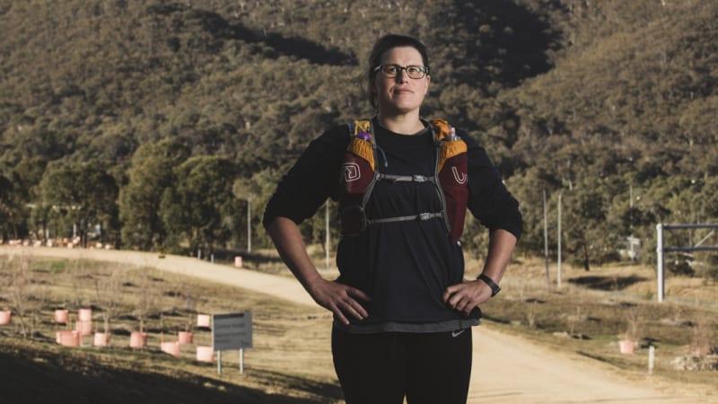 Canberra school teacher breaks triathlon world record