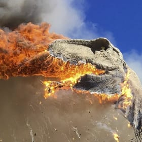 Holy smokes!  Giant T-rex goes up in flames