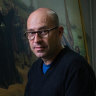 In the cold dark of the shuttered NGV, a conservator worries over dust