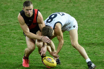 Callan Ward was accused of staging after being awarded a free kick for this incident with Essendon's Shaun McKernan.