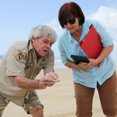 Ray Revill and Save Fraser Island Dingoes secretary Karin Kilpatrick inspect a coconut which appeared to have been eaten by the protected species.