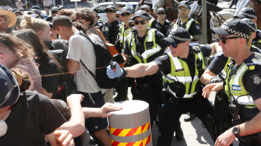 Police use pepper spray on protesters as they tried to top conference members entering IMARC.