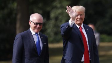 US President Donald Trump leaves Winfield House, residence of the US Ambassador Woody Johnson, left, during his visit to the UK in  July.