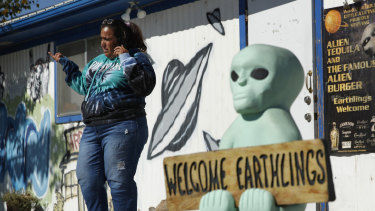 Little A'Le'Inn owner Connie West speaks on the phone outside of the bar and restaurant in Rachel, near Area 51, Nevada.