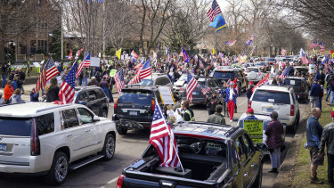 Hundreds of protesters gather outside Minnesota Govenor Tim Walz' official residence on Friday, April 17.