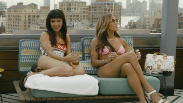 Constance Wu and Jennifer Lopez in a scene from Hustlers.
