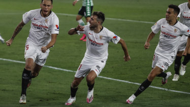 Lucas Ocampos salutes the empty stands in Seville after scoring in his side's 2-0 derby win over Real Betis.