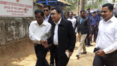 Myanmar's Social Welfare, Relief and Resettlement Minister Win Myat Aye arrives at Kutupalong refugee camp in Cox's Bazaar on Wednesday.
