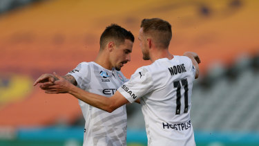 Jamie Maclaren and Craig Noone celebrate one of Maclaren's three goals.