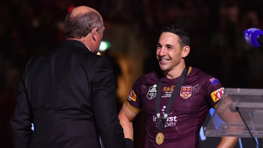 Controversial choice: Wally Lewis presents Billy Slater with the player of the series medal in 2018.