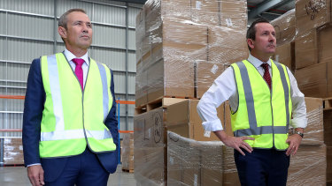 WA Premier Mark McGowan and Health Minister Roger Cook inspecting medical supplies on Monday before announcing just seven new COVID-19 infections in the state.