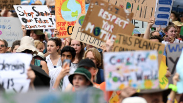 """School students join a """"climate change strike"""" in Brisbane earlier this year."""