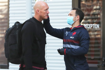 Roosters assistant Craig Fitzgibbon has his temperature checked after arriving at the club's Moore Park headquarters on Monday.