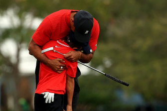 Tiger Woods hugs his son Charlie after their final round.