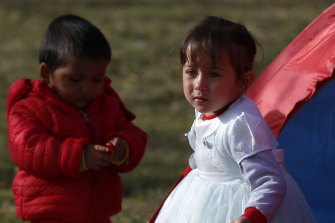 Children stand outside a tent in a field in Edirne, near the Turkish-Greek border on Sunday. Germany is considering taking in young children to help Turkey manage the increasing volumes of migrants and refugees.