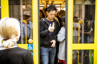 Commuters on a packed tram on Bourke Street on Wednesday.
