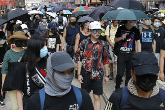 Protesters including ordinary Hong Kongers have marched in defiance of the mask ban.
