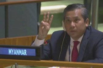 Myanmar Ambassador to the United Nations Kyaw Moe Tun flashes the three-fingered, a gesture of defiance used by protesters in Myanmar, at the end of his speech to the UN General Assembly on Friday.