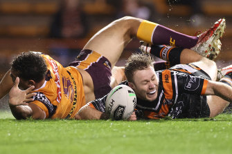 Tigers five-eighth Billy Walters wins the race to the ball to score a second-half try on Friday night.