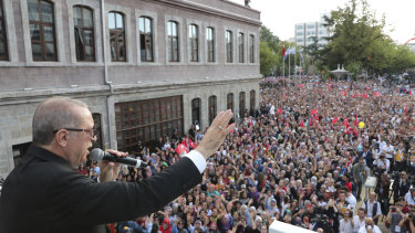 Turkish President Recep Tayyip Erdogan addresses supporters in Black Sea city of Trabzon, on Sunday. He has told citizens to swap their dollars for lira.
