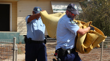 NSW Police officers from Strike Force Maluka examine Roxlyn Bowie's former house in Walgett.