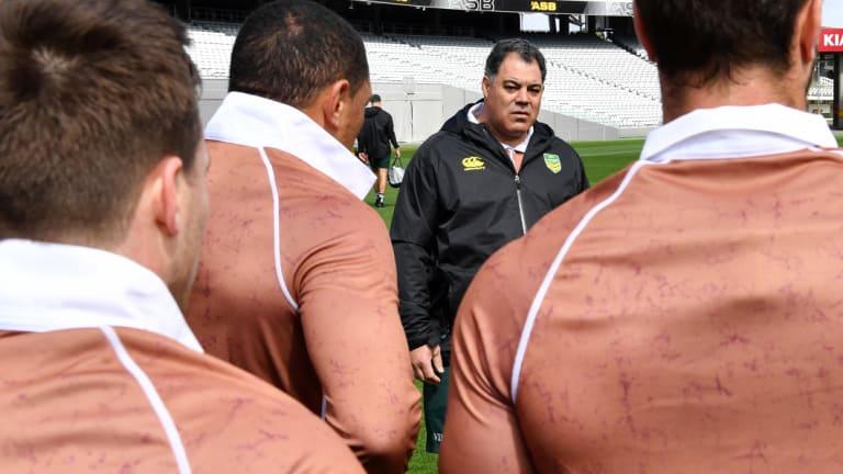 Mal Meninga addresses the Kangaroos dressed in commemorative brown.