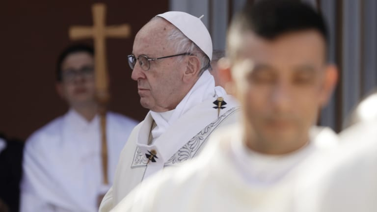 Pope Francis celebrates Mass in   Ostia during which he urged residents to stop protecting mobsters out of fear and side with the law.