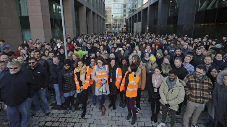 Employees gather outside Google's European headquarters in Dublin.