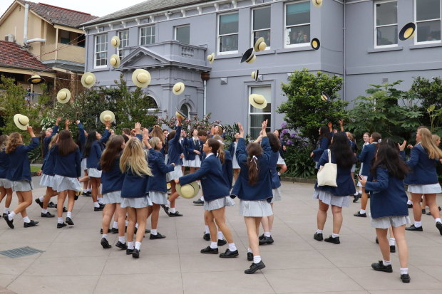 """Year 12 students at Shelford Girls' Grammar celebrate the end of the 2019 school year, before the school began a """"difficult restructure""""."""