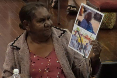 Madeleine Jadai brought photos to emphasize the importance of family to Indigenous people requiring aged care.