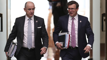 Government Services Minister Stuart Robert and Minister for Population, Cities and Urban Infrastructure Alan Tudge, who has also held the human services portfolio.